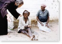 John with two Mutemwa residents